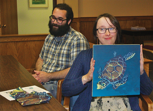 During the Town Board's work session last Thursday morning, illustrator Samantha Neukirch and her assistant, Joe Arias, presented her plans to install a mixed media mural project near the River and Roots community garden. (Credit: Barbaraellen Koch)