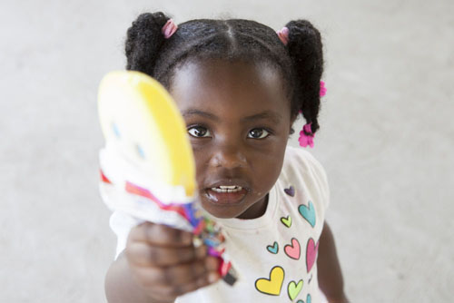 Amber Williams, 2, of Riverhead, demonstrating the importance of sharing at tk (Credit: Katharine Schroeder photos)
