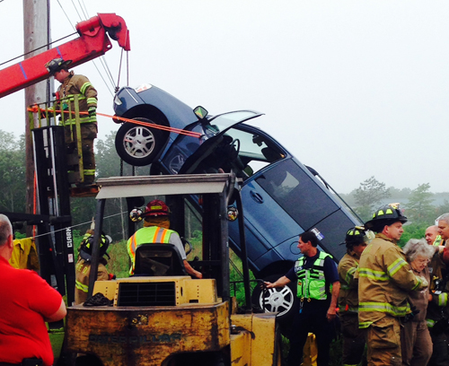 Firefighters work to rescue a woman who became trapped on Route 58 Friday morning (Credit: Cyndi Murray)