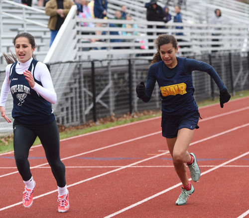 Shoreham-Wading River eighth-grader Katharine Lee races toward the finish line in the 400-meter race. (Credit: Robert O'Rourk)