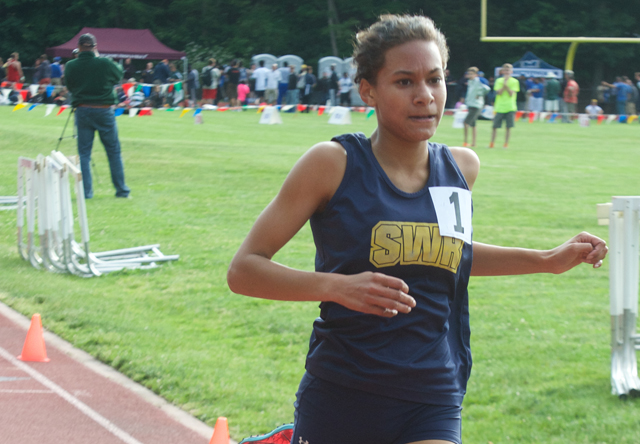 Shoreham-Wading River freshman Katherine Lee crosses the finish line of the 3,000 in first place Friday. (Credit: Robert O'Rourk)