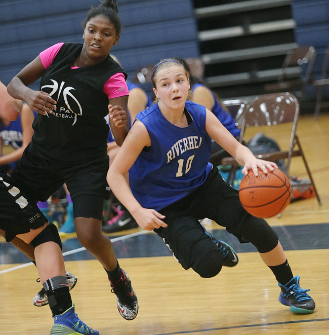 Riverhead guard Kate McCarney drives toward the basket against Deer Park Wednesday night. (Credit: Garret Meade)
