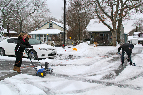 Brother and sister, Kayla and Christian Hojeski, clear their family's driveway.