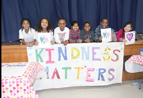 "SANDY KOLBO COURTESY PHOTO | Phillips Avenue Elementary School students pose with their ""Kindness Matters"" banner."