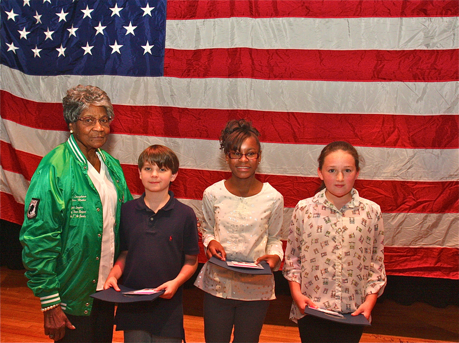 Medal of Honor recipient Pfc. Garfield M. Langhorn's mother, Mary Langhorn, with this year's sixth grade essay contest winners (from left) Christopher Donnelly, Alisha Griffin and Reilly Hubbard. (Credit: Barbaraellen Koch)