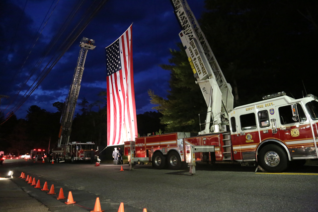 The American flag hangs outside the Wading River Fire Department Thursday night. (Photo Credit: Nicole Smith)