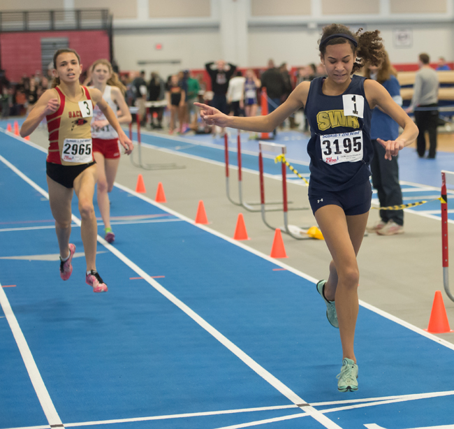 Shoreham-Wading River freshman Katherine Lee crosses the finish line first in the 3,000-meter race Sunday at the Section XI State Qualifier. (Credit: Robert O'Rourk)