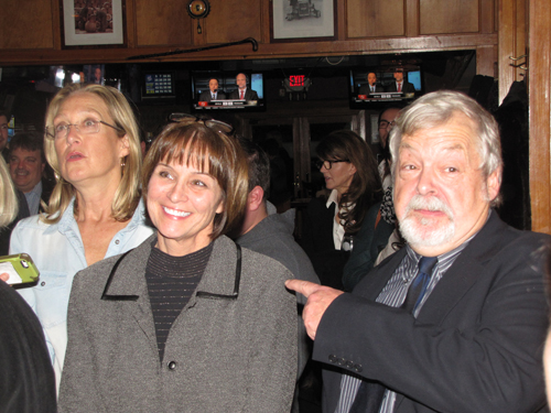 Julie Lofstad, center, celebrates her victory with Councilman John Bouvier, right, and County Legislator Bridget Fleming, left.