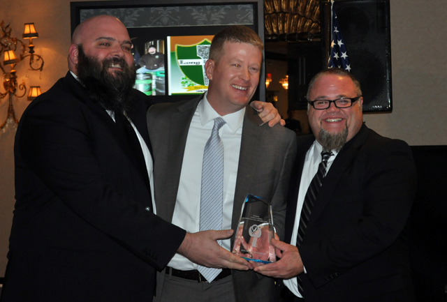 New chamber of commerce president Brian Curtin, center, presented the Entrepreneurial Achievement Award to Long Irleand co-owners Dan Burke (left) and Greg Martin in December. (Joseph Pinciaro file photo)
