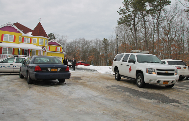 Riverhead police and Suffolk County Medical Examiner's office vehicles were parked outside the home on Kerry Court Wednesday morning as police investigated the death of a man there. (Credit: Carrie Miller)