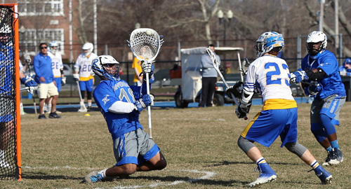 Mattituck/Greenport/Southold's Tim Schmidt scoring a goal against Riverhead goalie John Roca. (Credit: Daniel De Mato)
