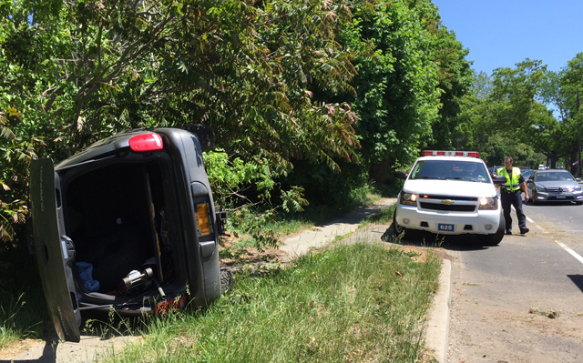 The driver of this overturned vehicle on Route 25 escaped serious harm Saturday afternoon. (Credit: Paul Squire)