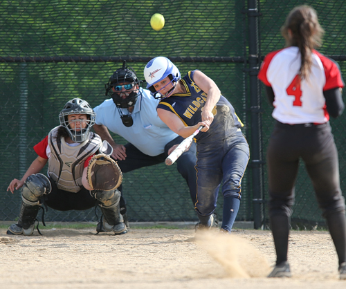 Shoreham-Wading River's Brittany Mahan connecting on a pitch from Mount Sinai's Holly Drasser. (Credit: Garret Meade)