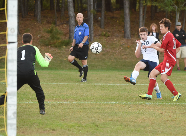 Shoreham-Wading River's Dan Mahoney fires a shot in the final seconds of Tuesday's game that hit off the crossbar, just missing on an equalizer. (Credit: Robert O'Rourk)