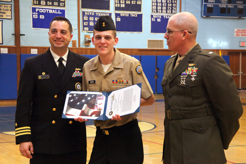 COURTESY PHOTO | Navy Officer Commander John Karin presents Cadet Anthony Mammina with the Meritorious Merit Award as Lt. Col. Peter McCarthy looks on.