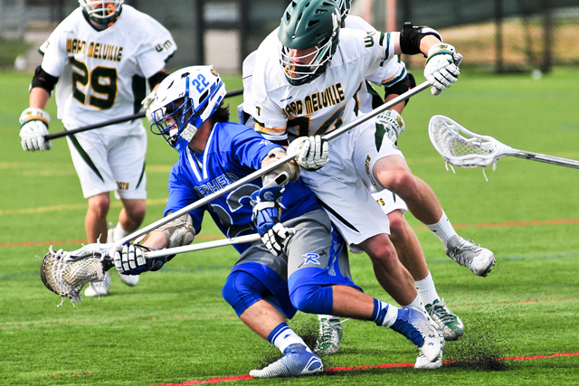 Riverhead's Mark Andrejack tries to elude the Ward Melville defender in Friday's playoff game. (Credit: Bill Landon)