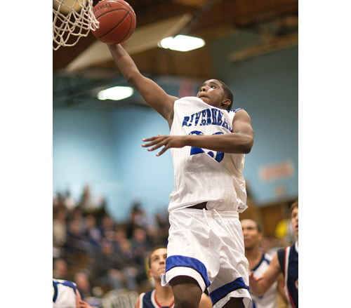 GARRET MEADE FILE PHOTO | Riverhead senior Markim Austin rises for one-handed dunk Tuesday that put the Blue Waves ahead by seven in the fourth quarter against Smithtown West.