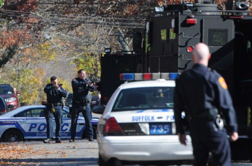 A nearly two-hour barricade in a Mastic house ended with three people coming out with hands up Wednesday, Nov. 19, 2014 in front of police with machine guns and armored vehicles. (Credit: James Carbone/Newsday)
