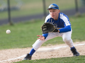 GARRET MEADE PHOTO | Mattituck third baseman Will Gildersleeve focuses on fielding a ground ball.