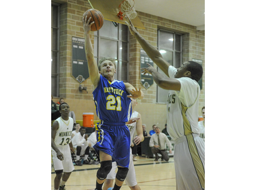 ROBERT O'ROURK PHOTO | Mattituck junior Will Gildersleeve scoring 2 of his career-high 30 points against Bishop McGann-Mercy on Tuesday night.