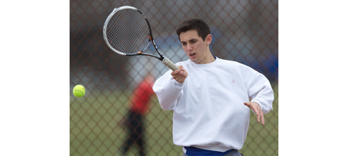Parker Tuthill brought Mattituck one of its three wins at singles, defeating Shoreham-Wading River's Brandon Porcele in two sets. (Credit: Garret Meade)