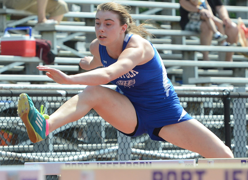 ROBERT O'ROURK PHOTO | Mattituck pentathlon athlete Shannon Dwyer competing in the 100-meter high hurdles on Friday.