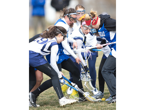 GARRET MEADE PHOTO | From left, Mattituck/Greenport/Southold's Tricia Brisotti, Riverhead's Carolyn Carrera, Mattituck/Greenport/Southold's Audrey Hoeg and Riverhead's Isabella LoPiccolo competing for a ground ball.