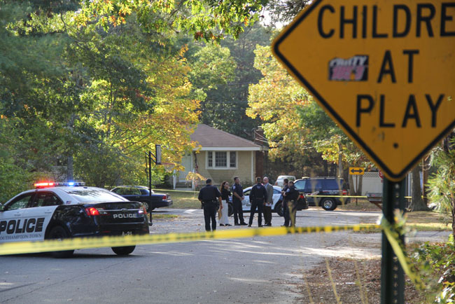 Police investigate the scene of an shooting on McKinley Street in Flanders Wednesday afternoon. (Credit: Carrie Miller)