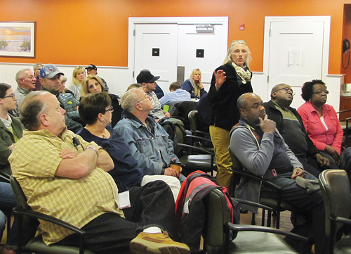 Flanders resident Chrissy Prete speaks out against a proposal to establish a municipal garbage district in the Flanders, Riverside and Northampton hamlets during a presentation on the plan at Friday's Waters Edge Civic Association meeting. (Credit: Tim Gannon)