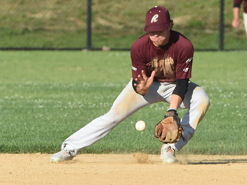 Riverhead Tomcats shortstop Danny Mendick fields a grounder in Game 2 of a doubleheader against Southampton Thursday. Mendick drove in six runs in the two games. (Credit: Robert O'Rourk)