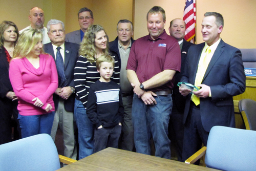 Highway Department maintenance mechanic Michael Zaleski, second from right, was presented with Riverhead Town's 2013 Employee of the Year award at the Feb. 19, 2013 Town Board meeting.  His wife, Kim, and son Ryan are pictured beside him. (Credit: Tim Gannnon)