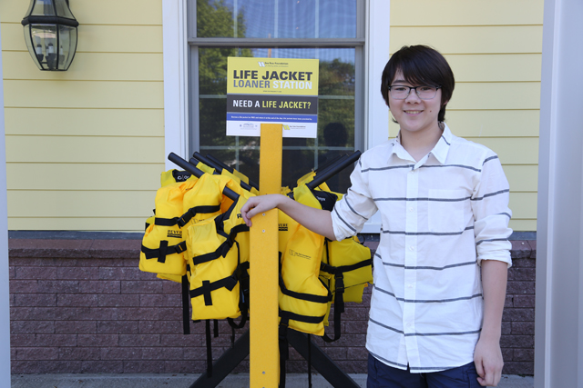 Southold 12-year-old Miles Eisenberg has been building life jacket stands Sea Tow that will be distributed around the country. (Credit: Krysten Massa)