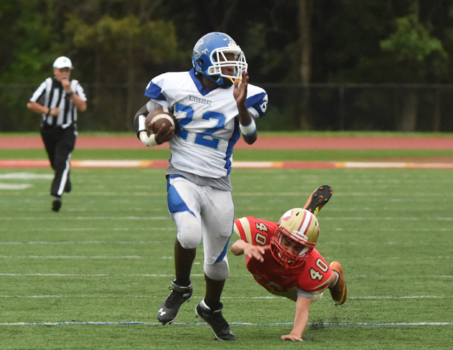 Riverhead junior William Mitchell eludes a final tackler on an 81-yard kickoff return for a touchdown Wednesday against Hills West. (Credit: Robert O'Rourk)