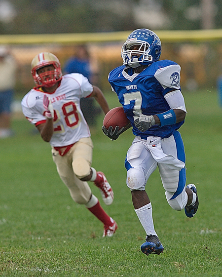 GARRET MEADE PHOTO  |  Riverhead wide receiver Reggie Moore scored on an 82-yard pass play on the Blue Waves' first play from scrimmage.
