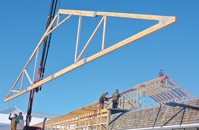 Workers with Shirk Construction of Pennslyvania putting up trusses on the addition to the Long Island Cauliflower building on Marcy Avenue in Polish Town in January. (Credit: Barbaraellen Koch)