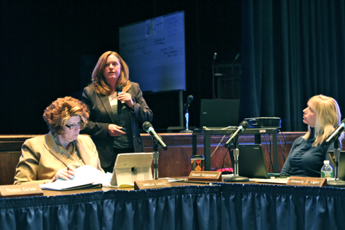 Riverhead School District Superintendent Nancy Carney, center, at Tuesday night's school board meeting. (Credit: Jennifer Gustavson)
