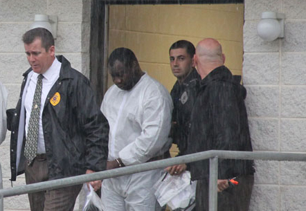 Kwame Opoku, 32, of Mastic Beach, being led to his arraignment on Oct. 16. (Credit: Carrie Miller, file)