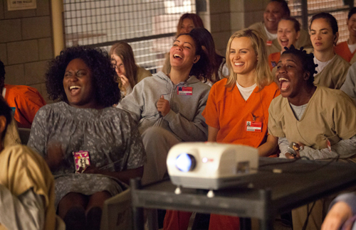 NETFLIX COURTESY PHOTO | Taylor Schilling, center, and castmates in a scene from season one of 'Orange is the New Black.'