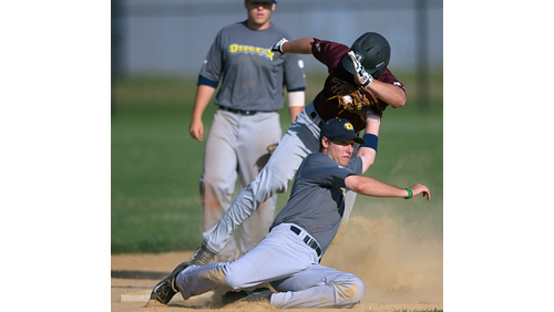 North Fork shortstop Luke Stampfl applied a tag, but Riverhead's Cole Fabio is called safe on his steal of second base in the third inning. (Credit: Garret Meade)