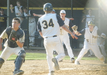 JOE WERKMEISTER PHOTO | Shoreham-Wading River junior Jonathan Criscito scores the game-winning run Wednesday against Bayport-Blue Point.