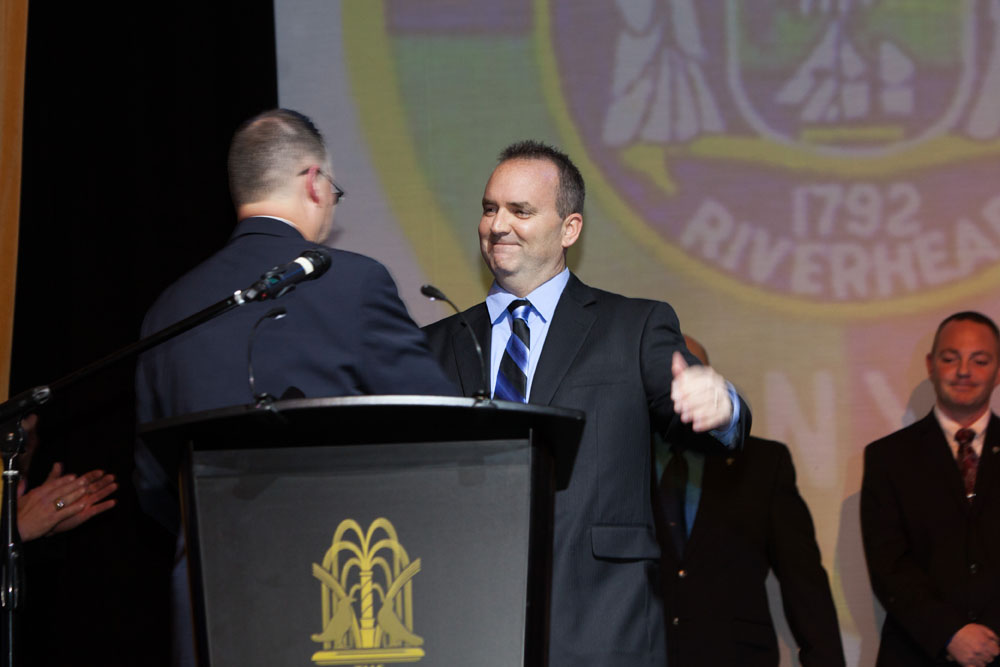 Dickson Palmer presents the PBA Member of the Year award to Officer Christopher Parkin.  (Credit: Katharine Schroeder)