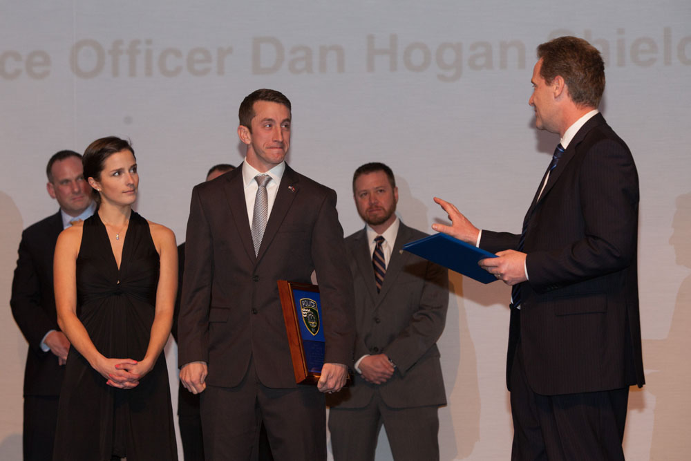 Town Supervisor Sean Walter presents a special proclamation to Officer Daniel Hogan. (Credit: Katharine Schroeder)