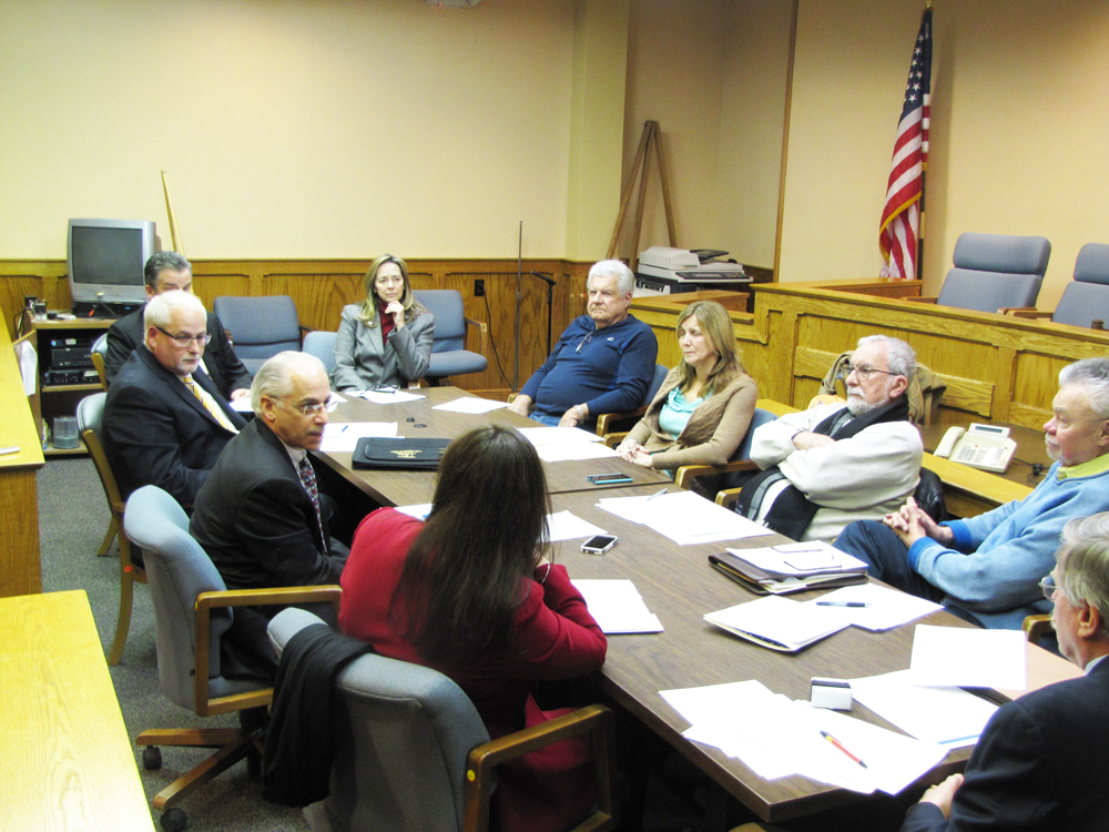 Peconic Bay Medical Center representatives meeting with Riverhead IDA officials in March. (Credit: Tim Gannon)