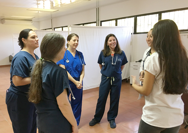 Nurses from PBMC talk with local staff and learn about the center in Jacuapa, El Salvador. (Credit: Laura Kelly)