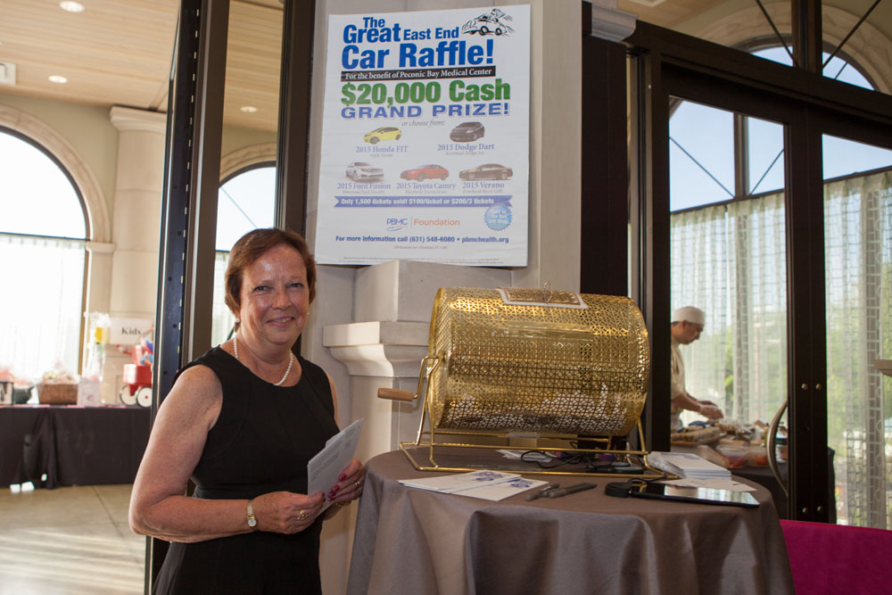 Stacy Higgins from the Peconic Bay Medical Center Foundation office mans the car raffle station.