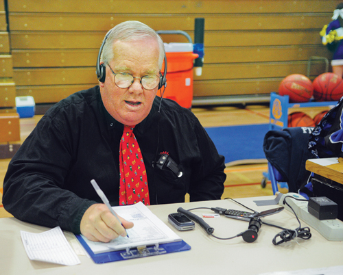 BILL LANDON PHOTO | Pat Kelly has been calling Riverhead football games for 25 years. The voice of the Blue Waves was at West Islip for last Tuesday's boys' basketball game.