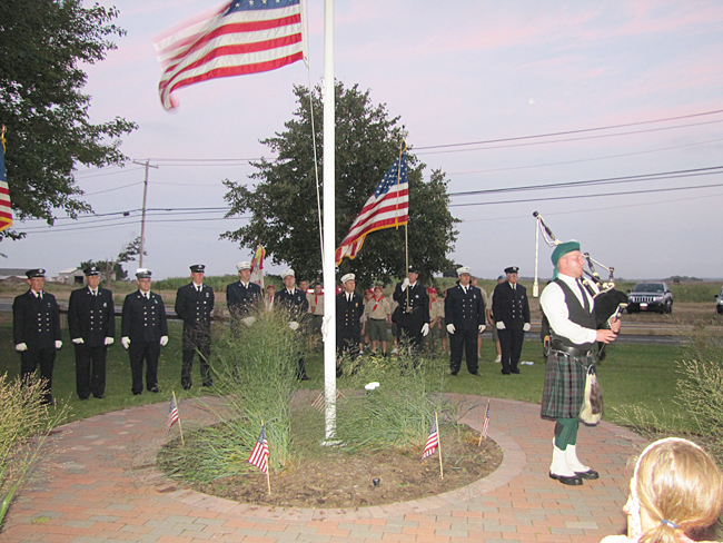 Patrick O'Neill plays the bagpipe during Thursday night's memorial at Reeves Park. (Credit: Tim Gannon)