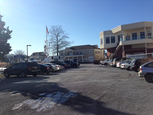 PAUL SQUIRE PHOTO | A 19-year-old Bellport teen fled a shooting in this marina parking lot in downtown Riverhead Wednesday night.