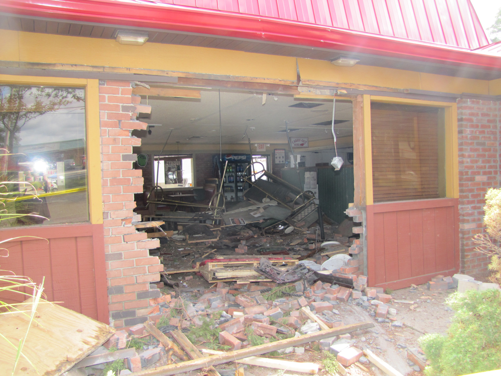 The Riverhead Pizza Hut, following a Sept. 17 accident in which a car crashed into it. File photo by Tim Gannon