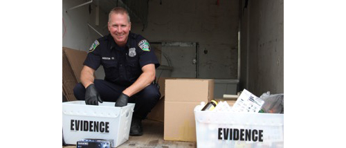 Riverhead Police Officer Rick Anderson weighing and packaging 102 pounds of drugs collected at the Take-Back Drive-Through event. (Credit: Courtesy)